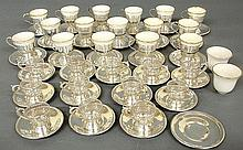 Group of sterling silver demitasse cups & saucers, some with porcelain liners TI 28 saucers, largest 4
