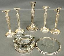 Five weighted sterling silver candlesticks, tallest 9