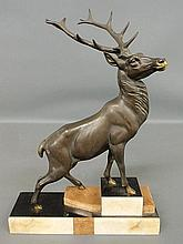 Bronze of a standing elk, mounted on an Art Deco style marble base. 21.5