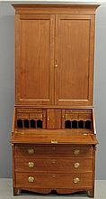 Pennsylvania Hepplewhite walnut two-piece secretary bookcase, c.1790, with a molded cornice above two blind doors opening to a shelved interior over a lower section with a lift lid opening to a pigeonholed and document drawered interior over four