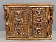 Jacobean oak cabinet with extensively carved doors with grotesque face masks and lion heads. 43