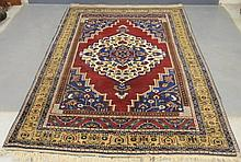Colorful Heriz type oriental carpet with red field and overall geometric patterns. 6'1