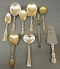 Group of sterling silver serving pieces by various makers and in various patterns, 12 troy oz., and a cake knife with stainless blade.
