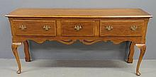 Queen Anne style walnut huntboard with three inlaid drawers and shell carved knees. 34.5