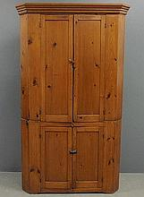 Pine two-piece blind door corner cupboard, c.1860, with a molded cornice. 81