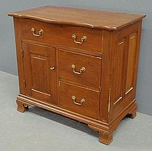 Chippendale style pine cabinet with ogee feet. 29