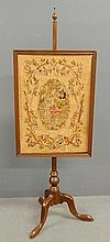 Queen Anne style mahogany fire screen with a rectangular needlepoint panel of a courting scene. 54