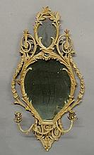 Continental mirror with an ornately carved frame, c.1790, and with candle holders. 39