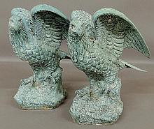 Fine pair of faux verdigris surfaced cast metal filled with plaster standing eagles, 20th c. 18