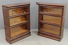 Globe-Wernicke two-part mahogany corner bookcase, each part with three shelf components with glass lift doors. 47