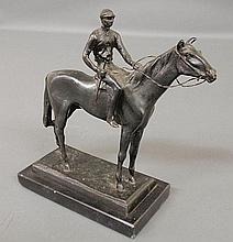 Equine bronze of a jockey on a standing racehorse and mounted on a black metal base, signed