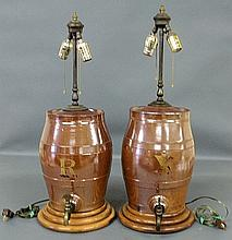 Pair of English ceramic liquor casks, late 19th c., with brass spigots, mounted on maple bases and converted to electricity. 29