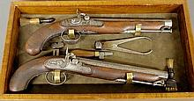 Brace of English percussion pistols, early 19th c., with octagonal barrels signed