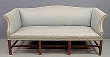 Chippendale style mahogany sofa with molded legs and stretcher base. 34