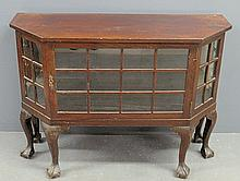 Chippendale style mahogany and glass display cabinet with ball & claw feet. 34.5