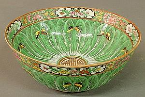 Small Chinese porcelain punch bowl, 19th c., with leaf and butterfly decoration. 3.75