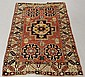 Colorful Caucasian oriental mat with center geometric medallion, four rosettes and red field. 4'6