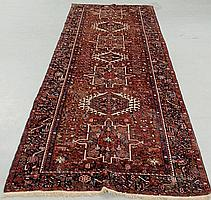 Heriz oriental hall runner with seven geometric medallions and red field. 4'9