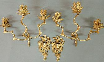 Fine pair of rococo bronze fire gilt sconces, c.1800, each with spread-winged eagle backplate and  three-arms with foliate candleholders, 15