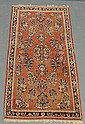 Red Sarouk oriental mat with floral patterns.