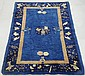 Blue Chinese oriental mat with bird and potted flower motifs. 4'10