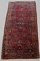 Sarouk oriental runner with red field and floral patterns. 2'6