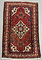 Persian oriental mat with a red field and center medallion. 3'4