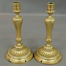 Pair of French brass candlesticks, 19th c., with beaded circular bases drilled for electrical cords. 10.5