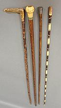Four walking sticks incl. an ivory tipped example w/band marked