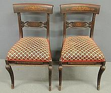Pair of Philadelphia mahogany saber-leg side chairs, c.1820, with fancy gilt stencil decoration. 33.5
