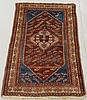 Hamadan oriental mat with a red field and blue corners. 2'7