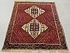 Oriental center hall carpet with a red field and ivory center medallion. 5'10
