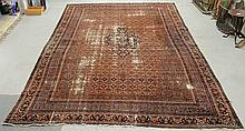 Palace size Bidjar oriental carpet with a red field, center blue medallion, overall floral patterns and floral borders. 19'8