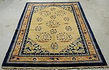 Chinese Peking oriental carpet with a beige center, blue border and flower and bird designs. 9'3