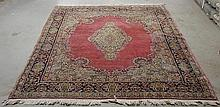 Kerman oriental carpet with a dark pink field, center medallion and floral patterns. 9'8
