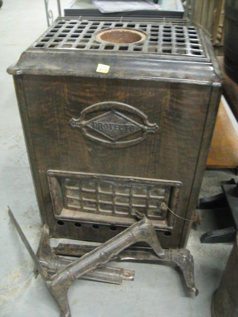 "Protecto Cast Iron Gas Stove 34"" Tall"