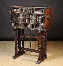 A 17th Century Spanish Vargueno fitted with a variety of small drawers and side cupboards.  The orna