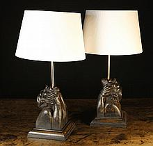 A Pair of Figural Oak Occasional Lamps.  The bases carved in the form of grotesques with theirs head