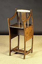 An Unusual 19th Century Oak Child's High-Chair/Rocker:  The box form seat with slatted back supports