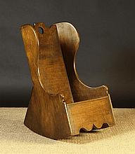 An 18th Century Child's Boarded Mahogany Rocking Commode Chair.  The plank back with fretted round h