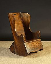 An 18th Century Child's Boarded Elm Rocking Commode Chair.  The plank back with fretted hand-hold.
