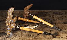 Three Antique Treen Lark Lures. The spinning winged mahogany heads studded with mirrored insets; eac