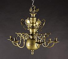 A 17th Century Bronze Six Branch Chandelier.  The knopped stem surmounted by a crowned eagle and inc