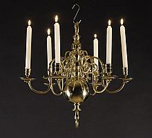 A Small 19th Century Brass Six Branch Chandelier. The S-scroll branches attached to a knopped stem a