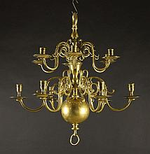 A Near Pair of Fine 19th Century Twelve Branch Brass Chandeliers having two graduated tiers of crest