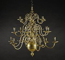 A Large 19th Century Eighteen Branch Brass Chandelier having three graduated tiers of crested zoomor
