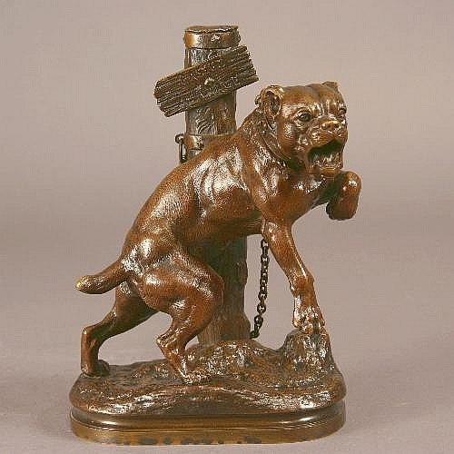 C.H. Valton. A Brown Patinated Bronze Figure of a Bull Dog chained to a post inscribed 'Passez au Large', on an oval base signed CH Valton, 10 ins