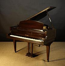 A Baby Grand Piano by Challen in a straight
