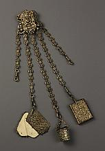 A Decorative 19th Century Chatelaine hung with