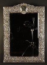 An Easel Mirror in a Silver Clad Frame. The
